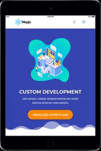tablet met custom development pagina